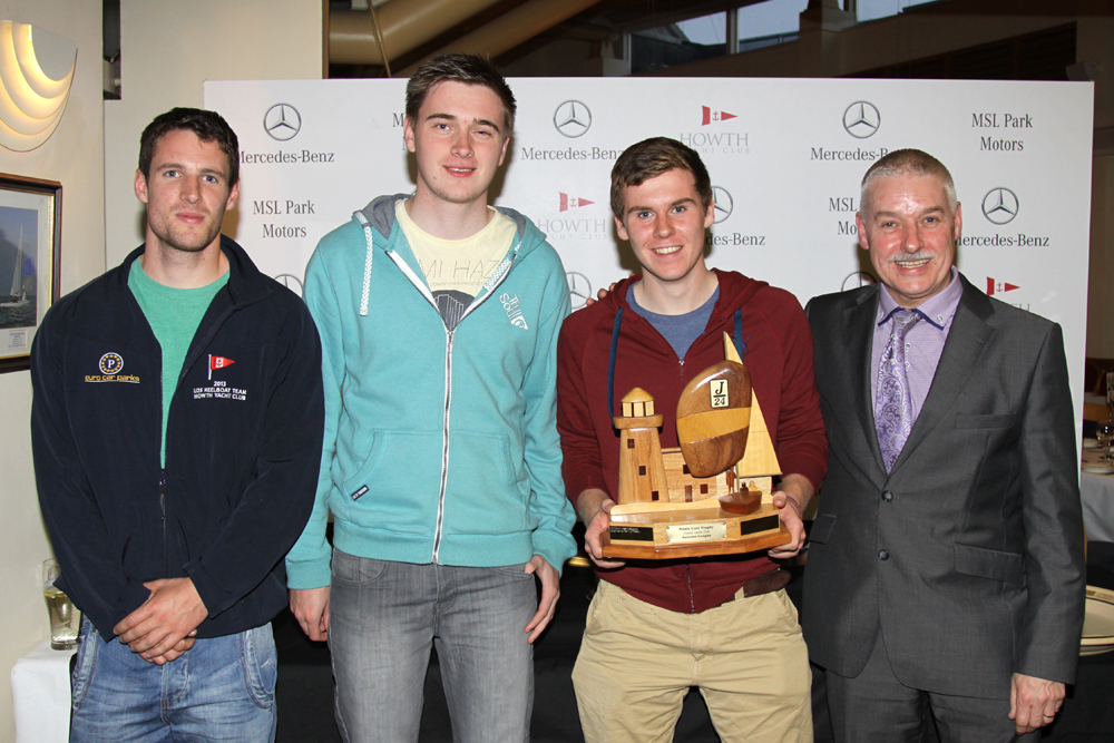 Gordon Stirling, Cian Manly and Harry Cronin collect the PAB Travel Trophy from MSL Park Motors Group Managing Director Brendan Grace