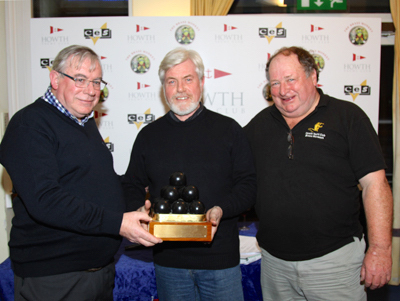 Roy Glynn (centre) is presented the Liam McGonagle Brass Monkey Trophy from Pat Connolly and David Appleyard