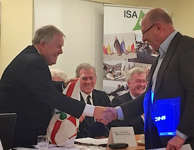HYC's Robert Dix is presented with his ISA burgee by President David Lovegrove