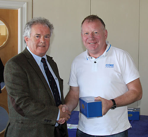 Vice Commodore Berchmans Gannon presents Paddy Kyne (Maximus) with first prize in Class 1/2 combined