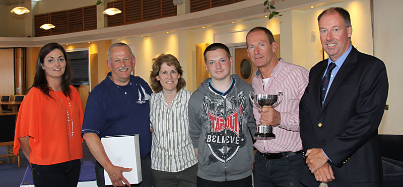 Charlotte O'Connor, crew of handicap winners 'Shiggy' with skipper Gerry Kennedy and Commodore Brian Turvey on right