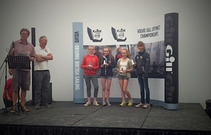 Eve McMahon (in red) collecting her prize as 5th girl overall