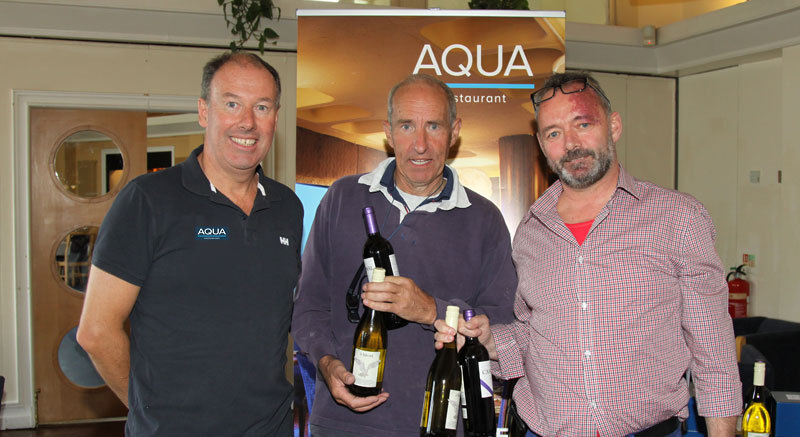 Commodore Brian Turvey with Richard McAllister (Force Five) and Aqua Restaurant's Dave Murnane