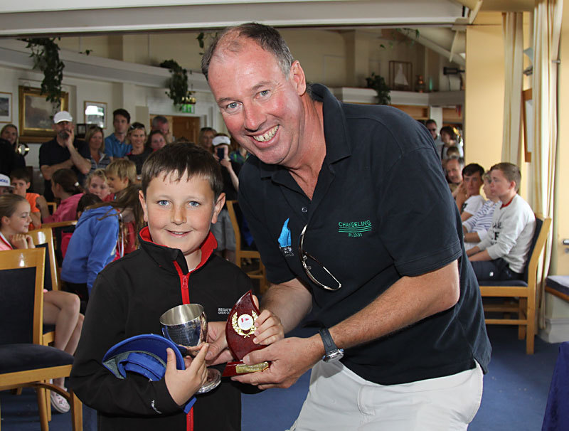 The RStGYC's Trevor Bolger receives the Drisheen Cup for winning the Optimist Main Fleet prize