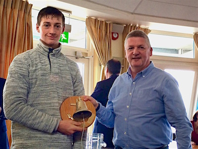 Ewan McMahon is presented the Seaward Bell Trophy by Kevin Darmody