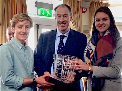 Ush Hamilton and Georgina Corbett are jointly presented with the 'Instructor of the Year Trophy' by Commodore Brian Turvey. Ush travelled from Galway to collect the prize, while Georgina had flown from Spain for the Awards