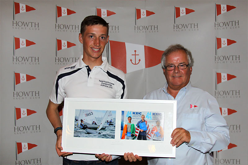 Ewan McMahon is presented with a framed set of photos by Commodore Berchmans Gannon