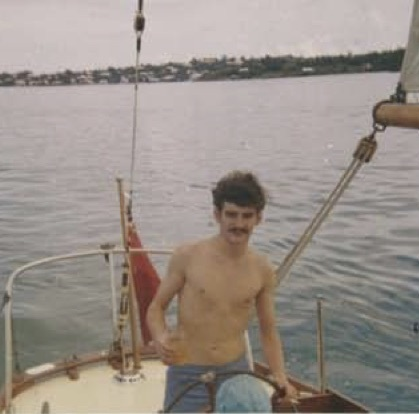 Rum & ginger and a smoke at the wheel in Hamilton Harbour 1969 (right) - Sail training was tough in those days.