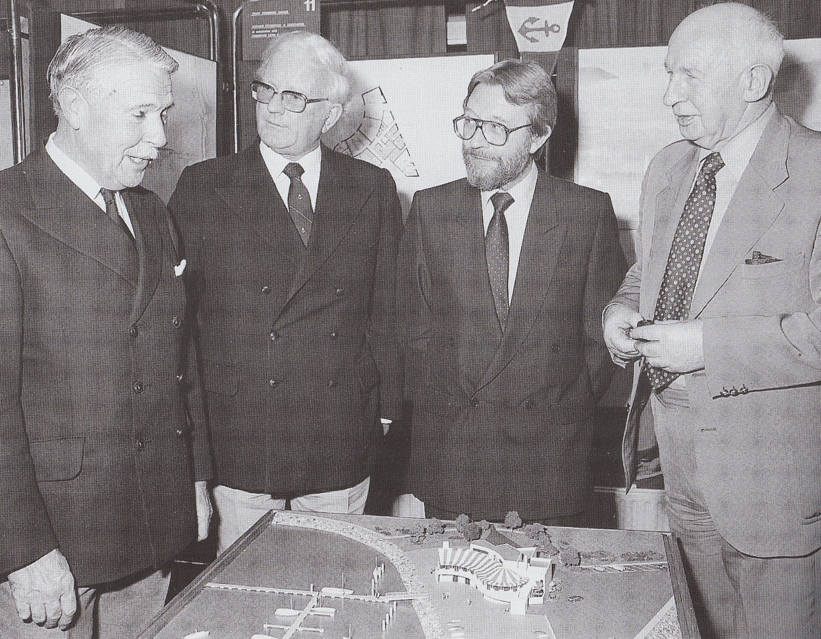 After the competition organised by the Royal Institute of Architects in Ireland for a new clubhouse design attracted 18 entries, the winning project was unveiled in November 1984. With the model of the proposed new building are (left to right) Bill Cuffe-Smith (Commodore Howth YC), architects Vincent Fitzgerald and Reg Chandler, and Martin D Burke, President of the RIAI.
