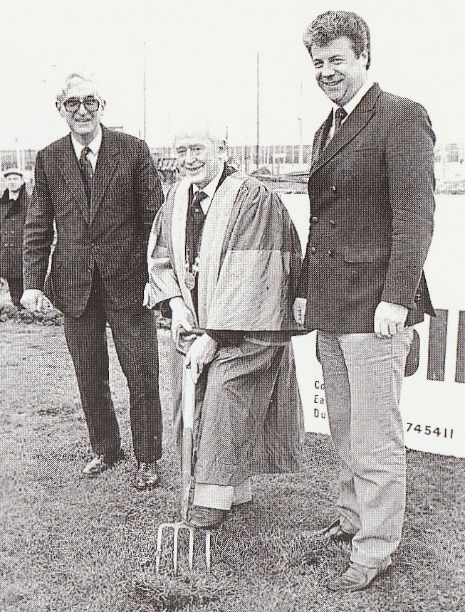 The building work finally starts. At the turning of the first sod on November 23rd 1985 are (left to right) Lyall Collen of contractors Collen Brothers, lifeboat cox'n Gerry McLoughlin in his role as Lord Mayor of Howth, and HYC CommodoreTom Fitzpatrick.