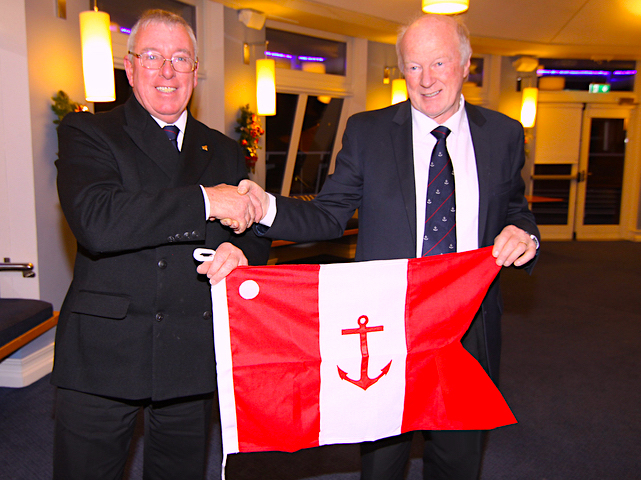 Vice Commodore Paddy Judge receives his flag