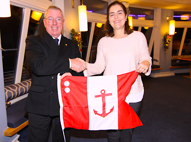 Rear Commodore Sara Lacy receives her flag
