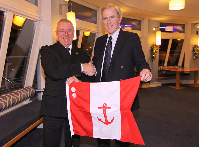Rear Commodore Neil Murphy receives his flag
