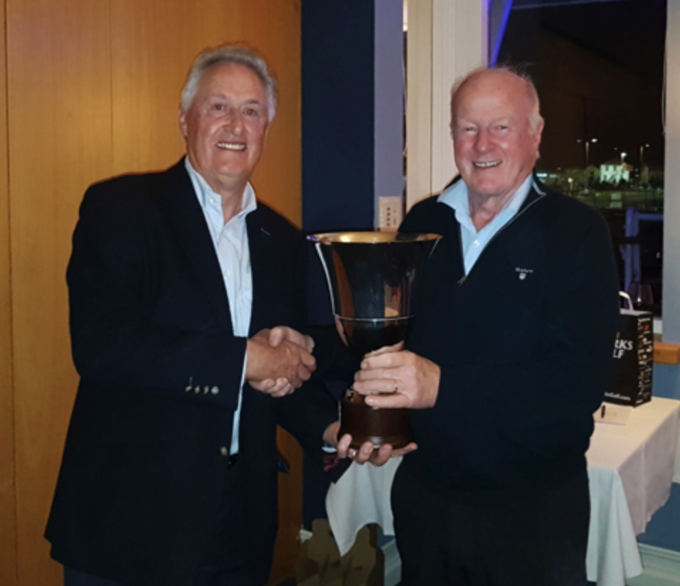 The Fulmar Cup is presented to Conor Holmes by IEGS Captain, Vice Commodore Paddy Judge