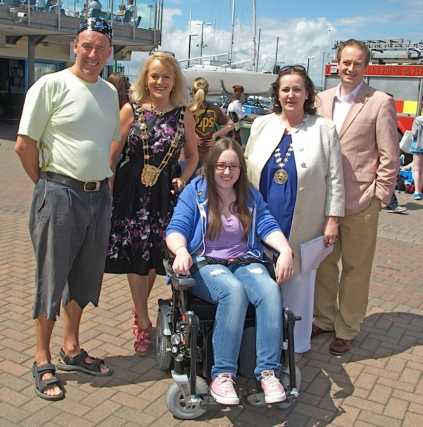 The Commodore, Mayor, Chief Barker of Variety and Fingal Councillor Keith Redmond with Naomi in her newly presented wheelchair