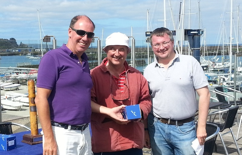 Peter Courtney collects 2nd prize from Commodore Brian Turvey and Marcus Lynch