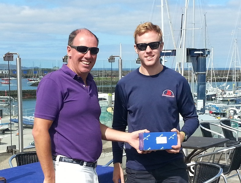 Simon Rattigan collects 3rd prize from Commodore Brian Turvey
