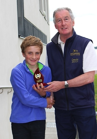 Optimist Gold Fleet 2nd placed William Lacy collects his prize