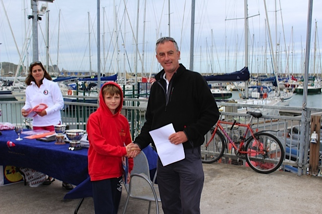 Jack McDowell recieves his Regatta Fleet 3rd place prize from Rear Commodore Richard Kissane