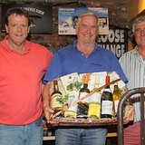 Colm Bermingham is presented with the Overall Prize by Barry Gibney and Dermot Skehan