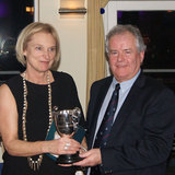 Wendy Morrison (Toughnut) collects the 'Audrey Pearson Trophy' from Commodore Berchmans Gannon