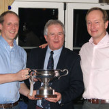 Commodore Berchmans Gannon with Michael and Richard Evans and the 'Mischief Cup'