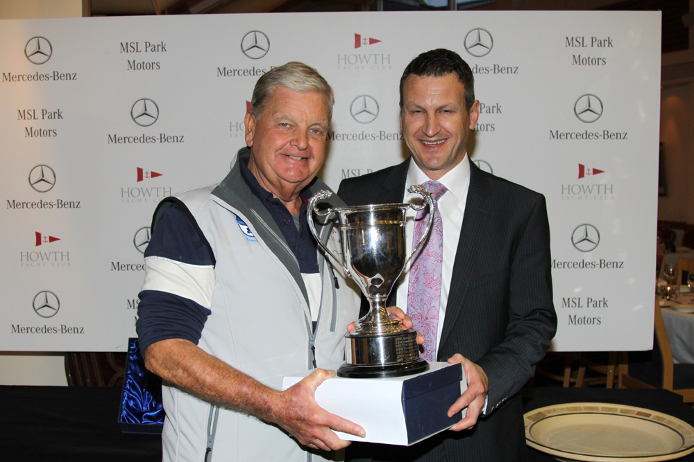 Pat Kelly (Storm) with the Evora Trophy and Dean Fullston
