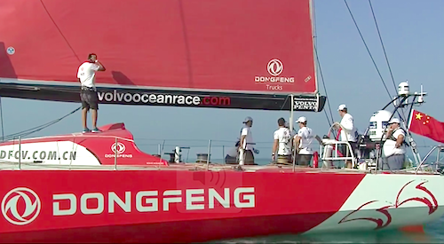 HYC's Dave Cullen positioned under the Chinese national flag as the Dongfeng team wait for the wind to build before the start of the In-Port Race