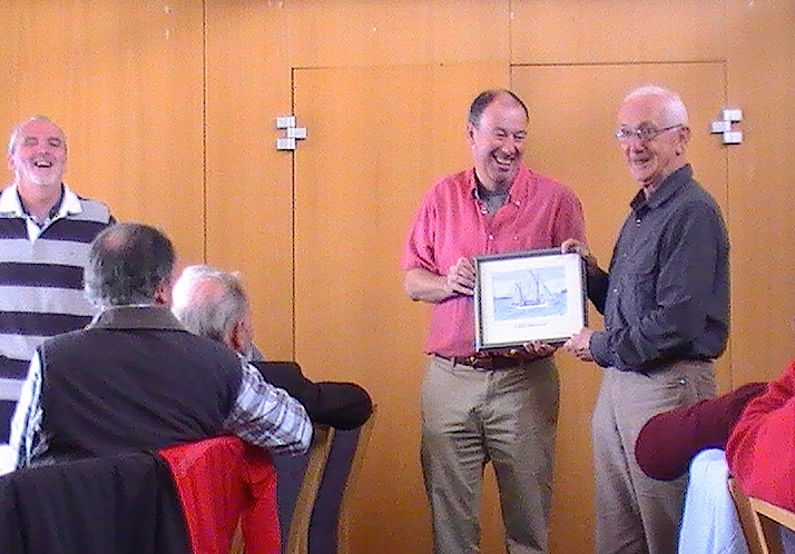 Joe Phelan accepts the Asgard II prize from the Commodore