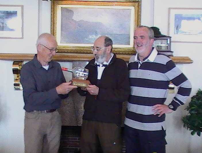 Joe Phelan presents Joe Nolan with the Asgard II trophy while Cruising Class Captain Garry Davis looks on
