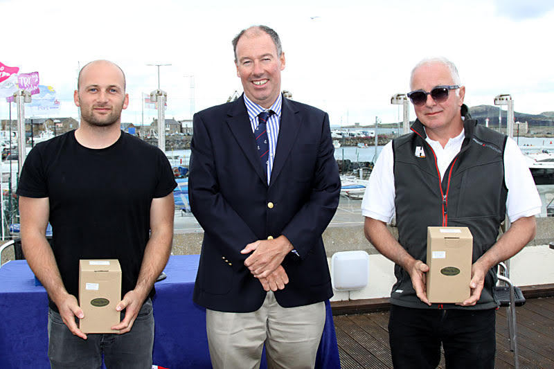 Gold Fleet winners - Nigel and Jack Grogan with Commodore Brian Turvey