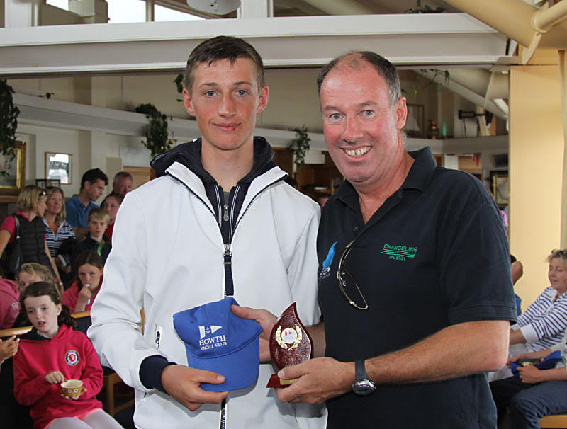 Ewan McMahon - winner of the Laser Radial prize with Commodore Brian Turvey