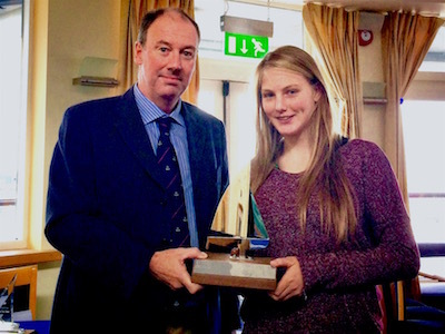 Commodore Brian Turvey presents the GM Trophy to Aoife Hopkins