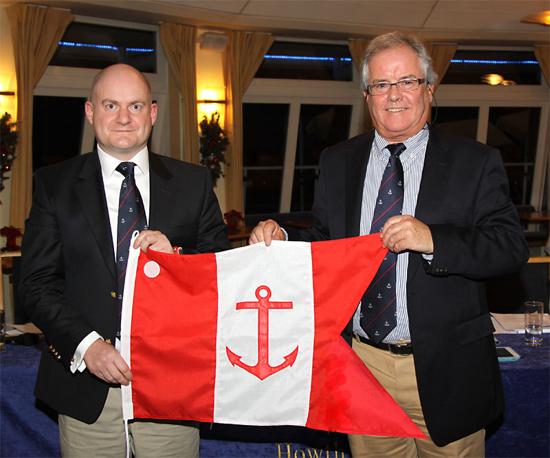 Emmet Dalton is presented with his Vice Commodore's burgee by Commodore Berchmans Gannon