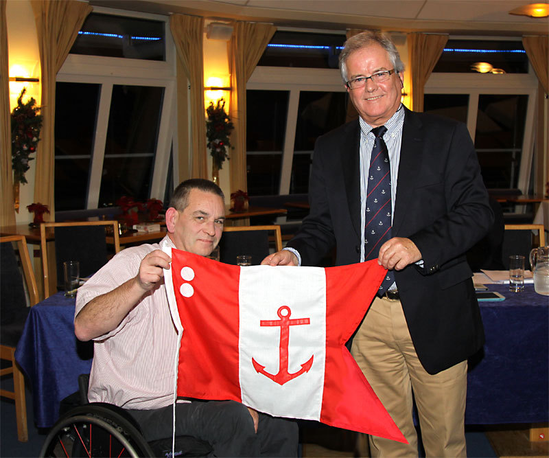 Feargal Kinsella accepts his Rear Commodore's burgee from Commodore Berchmans Gannon