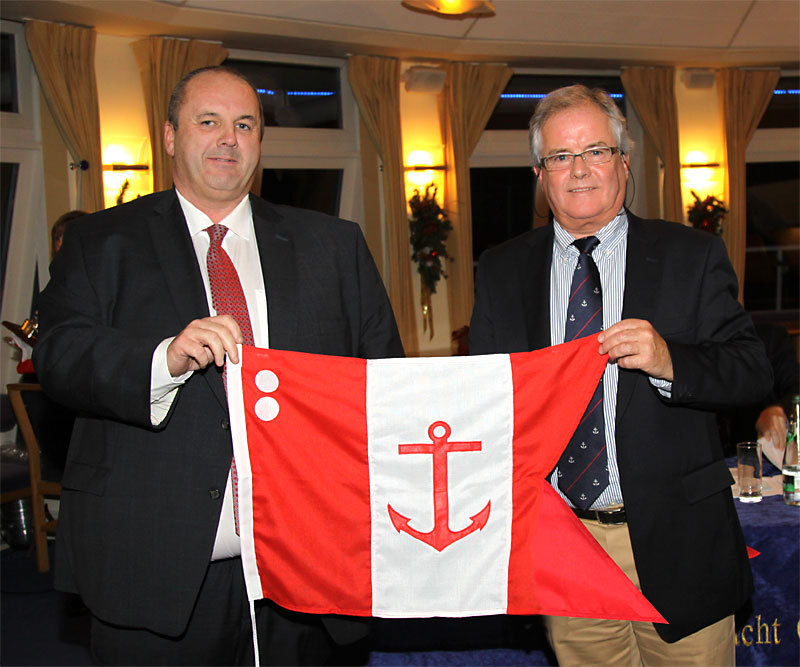 Rear Commodore David Cullen accepts his burgee from the Commodore