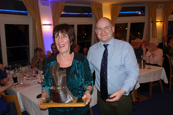 Sheila O'Reilly is presented the Ken Moles Trophy