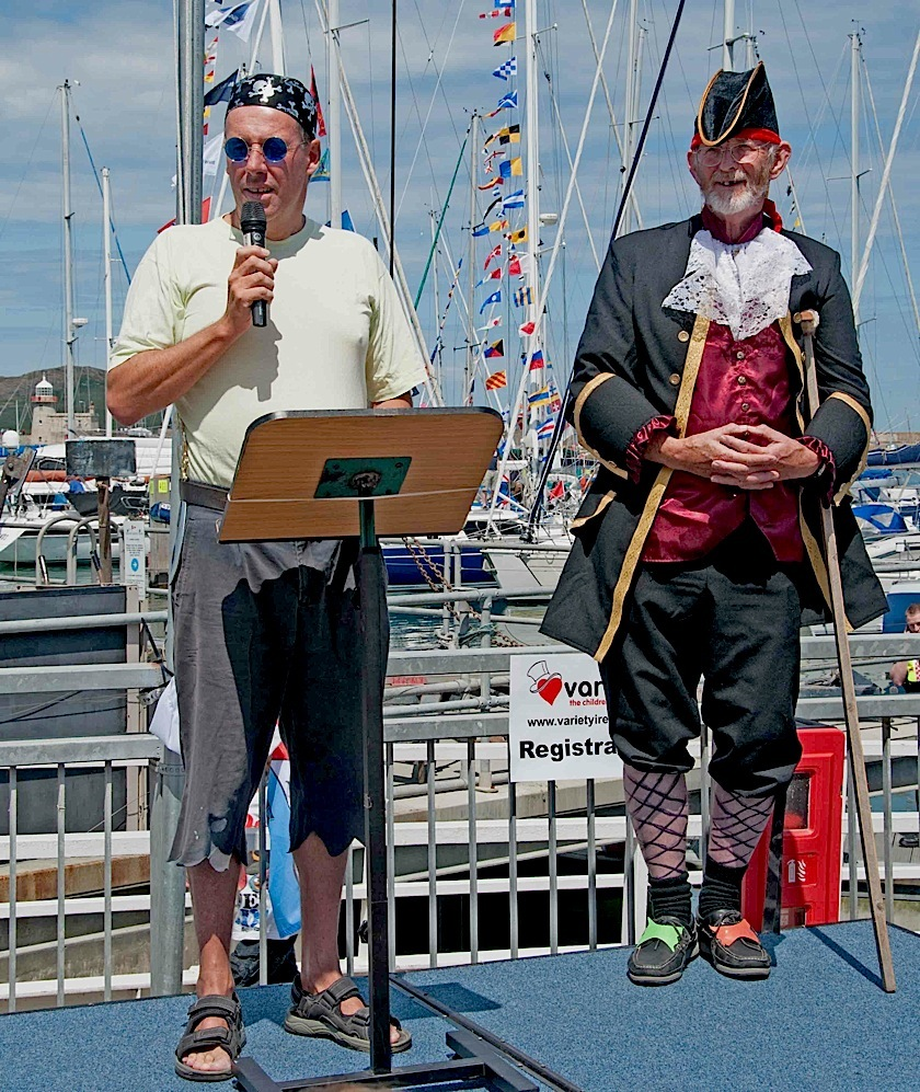 Guarded by 'Pirate Pat', Commodore Brian Turvey welcomes the visitors and thanks all concerned