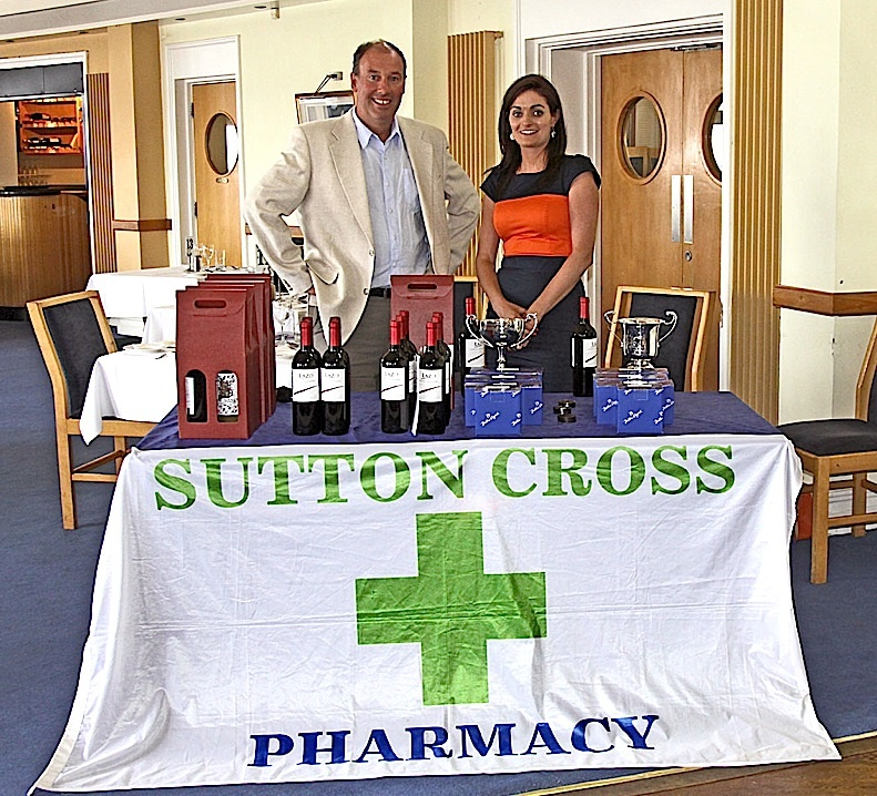 Commodore Brian Turvey with Charlotte O'Connor from Sutton Cross Pharmacy