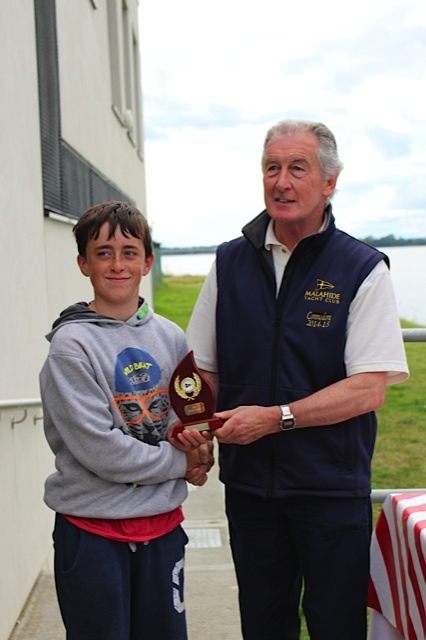 Max Kavanagh collect top Optimist Gold Fleet prize from MYC Commodore Graham Smith