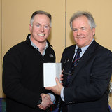 3rd in the Laser Standard Spring Series  Daragh Sheridan receives his award from Vice Commodore Berchmans Gannon 6328.jpg