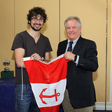 Event Organiser Ian McSweeney is presented with a club burgee by Vice Commodore Berchmans Gannon 6361.jpg