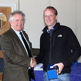Vice_Commodore_Berchmans_Gannon_presents_Richard_Evans_(The_Big_Picture)_with_his_prize.jpg