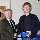Vice_Commodore_Berchmans_Gannon_presents_Shane_Murphy_(Dinghy_Supplies)_with_his_prize.jpg