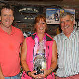 Steffi Ennis is presented 'Demelza's' prize for White Sails ECHO by Barry Gibney and Dermot Skehan