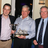 Pat Kelly (Storm) collects the 'Jim Keller Trophy' from Ross McDonald and Commodore Berchmans Gannon